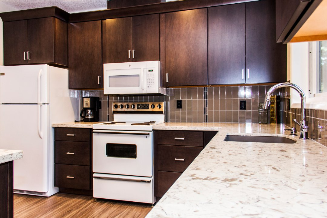 quartz countertops and wood cabinets