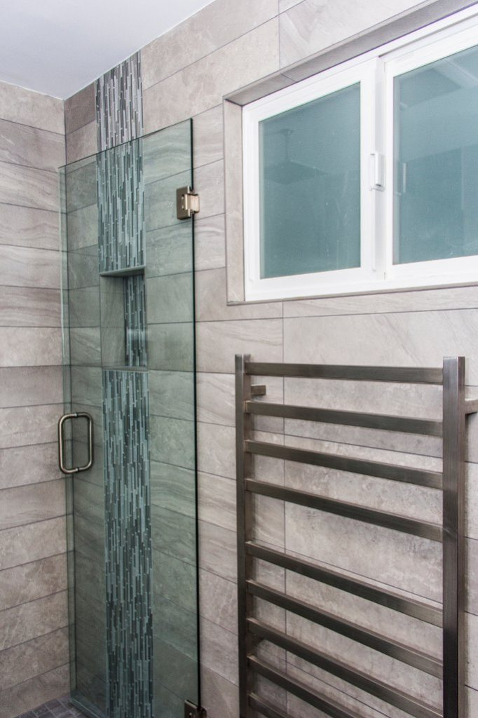 Seamless tile shower and towel warmer