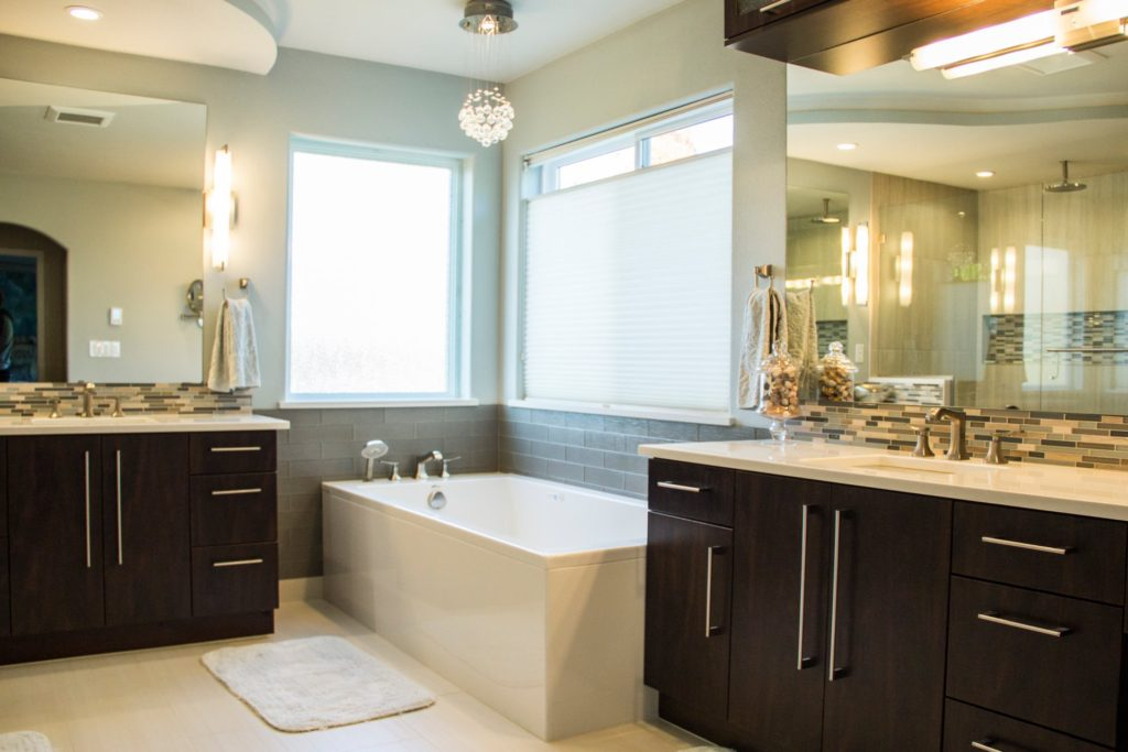 Walnut Cabinets With Nickel Handles Give This Bathroom A Good Pop Of Color The Freestanding Tub Completed The Spa Transition That Our Client Was Looking